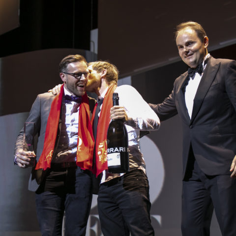 Chef Rasmus Kofoed and Søren Ledet on stage with Matteo Lunelli